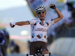 France's John Gadret reacts as he crosses the finish line to win the 11th stage of the Giro d'Italia  from Tortoreto Lido to Castelfidardo on May 18.