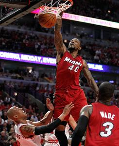 Miami Heat forward Udonis Haslem dunks against Keith Bogans of the Chicago Bulls in Game 2 of the Eastern Conference finals in Chicago.