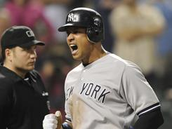 Alex Rodriguez reacts as he scores on a double by Robinson Cano in the 15th inning of the Yankees' 4-1 win over the Orioles. Rodriguez went 4-for-7 in the game.