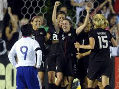 Heather O'Reilly, celebrating with her arms raised, scored a goal in the United States' 2-0 win over Japan in Cary, N.C. on Wednesday night.