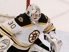 Goalie Tim Thomas was impeccable Thursday night, stopping 31 shots in helping Boston beat Tampa Bay 2-0. The Bruins lead the Lightning 2-1 in the series.