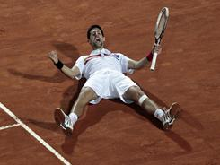 Novak Djokovic of Serbia has done a lot of celebrating in 2011, including this victory against Rafael Nadal in Rome. Can he do it again at the French Open in Paris?