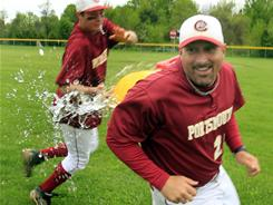 Quinn McCann, left, douses coach Tim Hopley after Portsmouth (N.H.) set a national record with its 76th consecutive victory.
