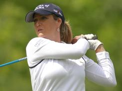 Cristie Kerr follows through on her tee shot on the eighth hole during her first-round match against Amanda Blumenherst on Thursday in the Sybase Match Play Championship in Gladstone, N.J.