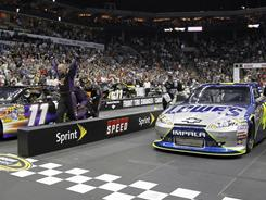 The No. 11 pit crew of NASCAR driver Denny Hamlin begins to celebrate after beating the No. 48 of Jimmie Johnson, right, for the Sprint Pit Crew Challenge championship.