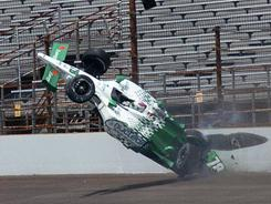 The car driven by IndyCar driver Simona de Silvestro, of Switzerland, crashes in the third turn during practice for the Indianapolis 500 at the Indianapolis Motor Speedway on Thursday.
