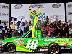 Kyle Busch celebrates his 97th career NASCAR win and 28th in the Trucks series.