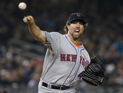R.A. Dickey confounded the Yankees with his knuckleball as the Mets took the opener of the Subway Series.