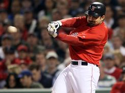 Adrian Gonzalez drove in four of the Red Sox's 15 runs as Boston moved past the rival Yankees in the standings for the first time this season.