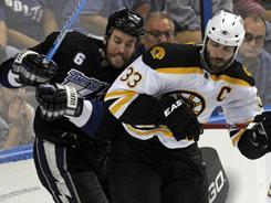 Bruins defenseman Zdeno Chara checks Lightning forward Ryan Malone during Game 3 in Tampa.