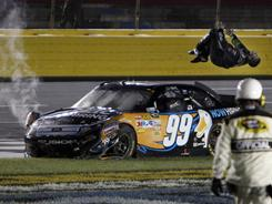 Carl Edwards does a backflip from his damaged Ford after winning the Sprint All-Star Race at Charlotte Motor Speedway.