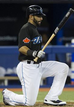 The Toronto Blue Jays' Jose Bautista is walked by Houston Astros pitcher Enerio Del Rosario during their game in Toronto.