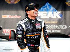 Alex Tagliani celebrates after winning the pole for the Indianapolis 500 at the Indianapolis Motor Speedway. He posted a four-lap average of 227.472 mph.