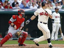 Travis Buck, right, hit a two-run home run off Homer Bailey in the seventh inning for the Indians' only two runs of the game. Josh Tomlin gave up just one run in the Indians' 2-1 win.