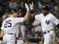 Curtis Granderson, right, is congratulated by teammate Mark Teixeira after hitting one of the Yankees' four home runs against the Mets. Teixeira also hit a home run in the third inning.