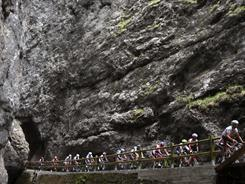 Cyclists pedal along a gorge during the 15th stage of the Giro d'Italia on May 22. Alberto Contador extended his already commanding lead while fellow Spaniard Mikel Nieve Ituralde won the grueling stage.