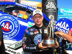 Robert Hight celebrates after winning the Funny Car event at the NHRA Summer in Topeka, Kan.