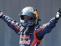 Sebastian Vettel celebrates after winning the Spanish Grand Prix, earnings his fourth win in five races this year.