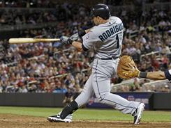 Luis Rodriquez hits the game-winning sacrifice fly in the tenth inning to beat the Minnesota Twins in the tenth inning Monday.