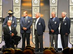 Maurice Petty, Richard Petty, Bud Moore, David Pearson, Ned Jarrett and Bobby Allison were inducted in the NASCAR Hall of Fame Monday in Charlotte
