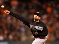 Florida Marlins pitcher Ricky Nolasco delivers to a San Francisco Giants batter during their game in San Francisco.