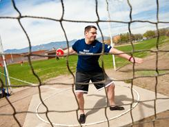 Justin Rose competes in the standing discus during the 2011 Warrior Games held in Colorado Springs on May 17. Rose suffered a traumatic brain injury and post-traumatic stress disorder during a July 2009 explosion in Iraq.