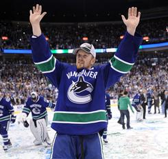 The Canucks' Henrik Sedin celebrates after their victory over the San Jose Sharks in double overtime of Game 5 to win the Western Conference finals in Vancouver.