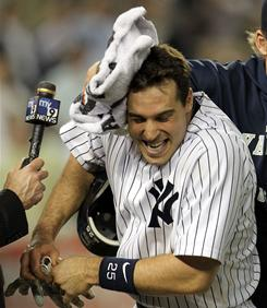 The Yankees' Mark Teixeira gets a towel with shaving cream in the face by teammate A.J. Burnett after  New York beat the Blue Jays.