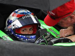 Danica Patrick, shown waiting in her No.7 Dallara-Honda during IndyCar qualifications Sunday, is running part time in NASCAR this season while mulling a full time entry in 2012.