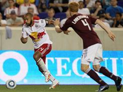 Thierry Henry, left, scored for the Red Bulls in their 2-2 draw against the Rapids. Jeff Larentowicz, right, scored both of Colorado's goals.