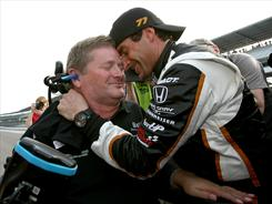 Driver Alex Tagliani, right, and team owner Sam Schmidt celebrate after Tagliani won the pole for Sunday's Indianapolis 500.