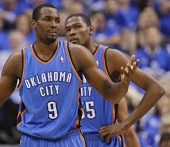 Oklahoma City Thunder forward Serge Ibaka questions a call in front of teammate Kevin Durant during their decisive Game 5 loss to the Mavericks in Dallas.