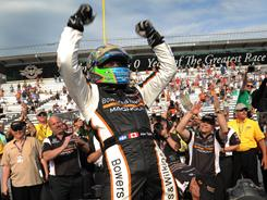 Sam Schmidt Motorsports driver Alex Tagliani celebrates winning the pole for the Indianapolis 500.