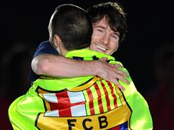 Lionel Messi, right, celebrating Barcelona's Spanish League championship, was the first player to score 50 goals in a Spanish League season.