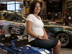 NHRA Funny Car driver Ashley Force Hood is due to have her first child Aug. 12.