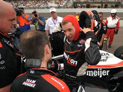 Will Power, exiting his car after a qualifying run, sees problems if drivers on double-file restarts try to pass leaders on the inside.