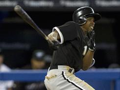 Juan Pierre hits the game-winning single during the ninth inning against the Toronto Blue Jays on Thursday, extending his hitting streak to 11 games.