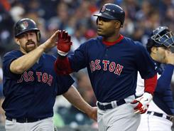 The Red Sox's Kevin Youkilis, left, congratulates Carl Crawford after Crawford hit a home run in the third inning against the Tigers. The Red Sox won 6-3 behind starter Tim Wakefield.