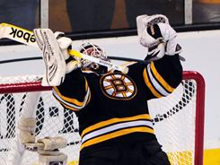 Tim Thomas celebrates after shutting out the Lightning to help the Bruins advance to the Stanley Cup Final for the first time in 21 years.