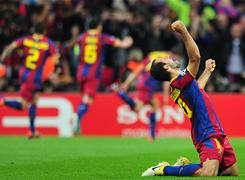 Barcelona midfielder Javier Mascherano celebrates the goal scored by forward David Villa during their UEFA Champions League final against Manchester United in London.