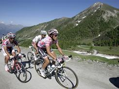 Overall leader Alberto Contador of Spain, right, pedals during the 20th stage of the Giro d'Italia. Belarus' Vasili Kiryienka won the stage, while overall leader Contador finished eighth maintaining his lead at the top of the standings.