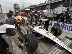 Polesitter Alex Tagliani, of Canada, makes a pit stop on the final day of practice on Friday for the Indianapolis 500. The 100th anniversary running of the Indianapolis 500 is Sunday.