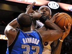 Heat forward LeBron James, right, is fouled by Mavericks center Brendan Haywood during Dallas' 98-96 home victory on Dec. 20. The teams open the 2011 NBA Finals on Tuesday in Miami.