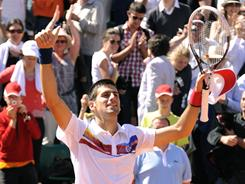Novak Djokovic of Serbia celebrates his 40th consecutive victory to open 2011, a 6-3, 3-6, 6-3, 6-2 win against Juan-Martin del Potro of Argentina on Saturday at the French Open.