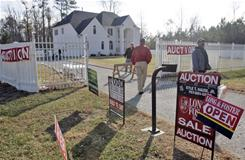 Prospective buyers arrive at the open house at the home once owned by Atlanta Falcons quarterback Michael Vick in Surry, Va., in 2007.