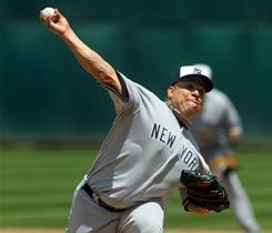 New York Yankees pitcher Bartolo Colon delivers against the Oakland Athletics in the sixth inning at Oakland-Alameda County Coliseum. The Yankees won 5-0.