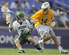 Mercyhurst's Brian Sheetz, left, tries to get past Adelphi's Wayne Marx during the NCAA Division II lacrosse final in Baltimore.