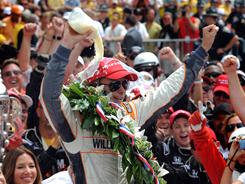 Dan Wheldon, winner of the 2011 Indy 500, pours the customary bottle milk over his head in Victory Lane after winning in stunning fashion on the last lap.