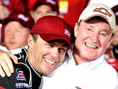 Kevin Harvick (left) celebrates with team owner Richard Childress in victory lane at Charlotte Motor Speedway after winning the Coca-Cola 600.
