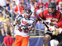 Colin Briggs, left, scored five goals to lead Virginia to its fifth national title in lacrosse and fourth under coach Dom Starsia.